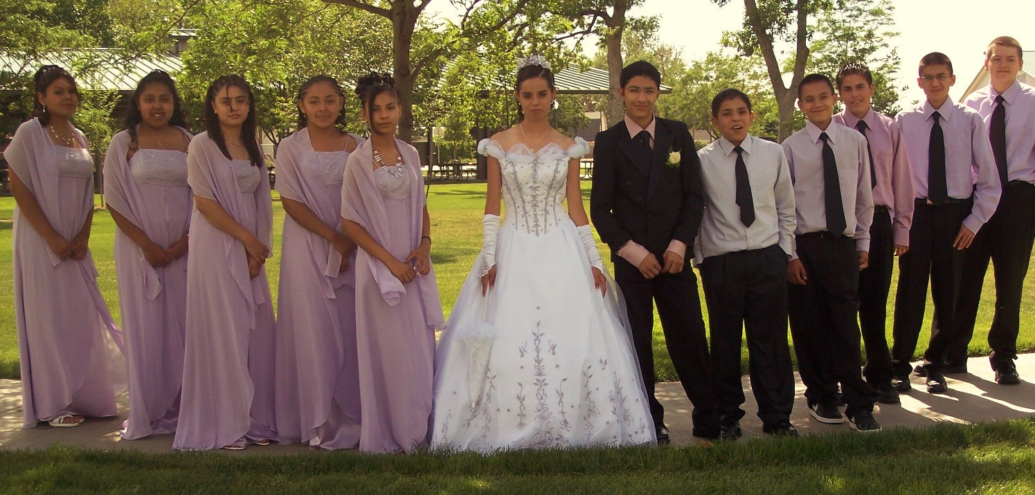 Quinceañera and her damas and chambelanes court in Greeley..